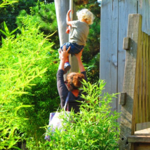 Mother and child playing on adventure playground